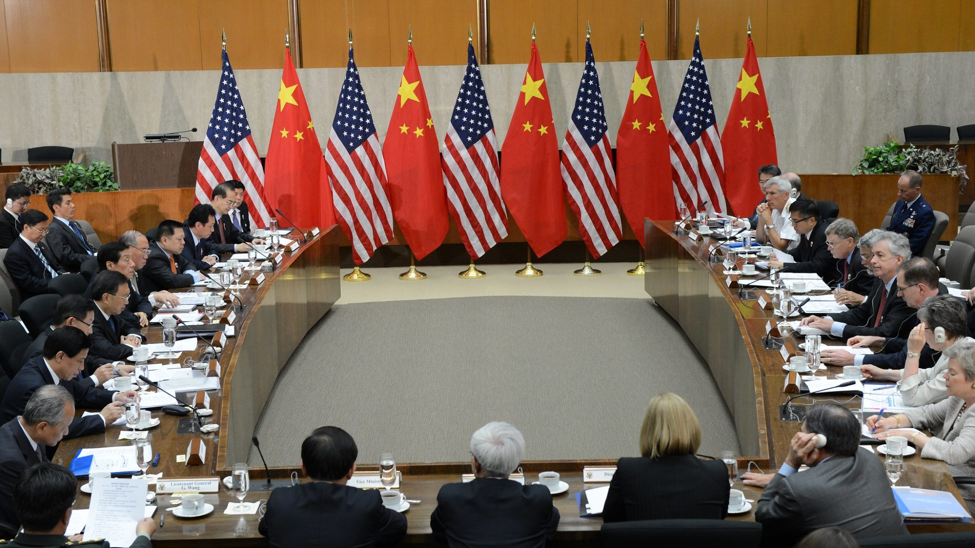 Chinese and American flags during international negotiations
